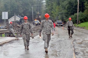 Members of the Maine National Guard take a break after working into the evening to fix damage caused by Hurricane Irene in Pittsfield, Vt., on Sept. 5, 2011. Photo by Jim GreenHill.