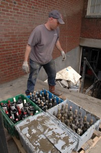 Chris Breen hauls expensive vintage wine bottles out of the muddy swamp that is now the basement of the Simon Pearce Restaurant in Quechee Village after Sunday's flooding from tropical storm Irene. VTD/Andrew Nemethy