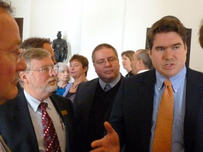 """Rep. Oliver Olsen, right, explains his position on the """"fair share"""" bill. Photo by Anne Galloway"""
