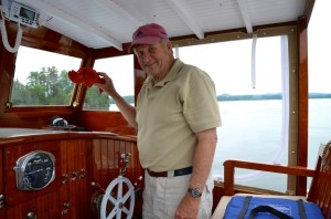 """Jan Rozendaal holds up """"Larry the Lobster,"""" his mascot for the Maddy Sue, an iconic 1932 Maine lobster boat he had restored that now cruises on Lake Champlain - not known for its saltwater crustaceans. Photo by Andrew Nemethy"""