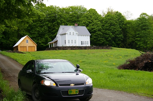 The home of Gov. Peter Shumlin on Foster Road in East Montpelier. A state police vehicle is parked at the end of the driveway on Friday, while the governor was at work. VTDigger