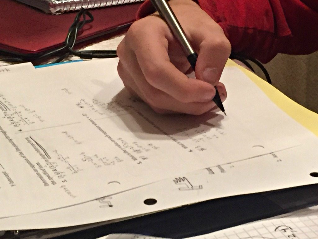 A high school student works on algebra homework. Photo by Cate Chant/VTDigger