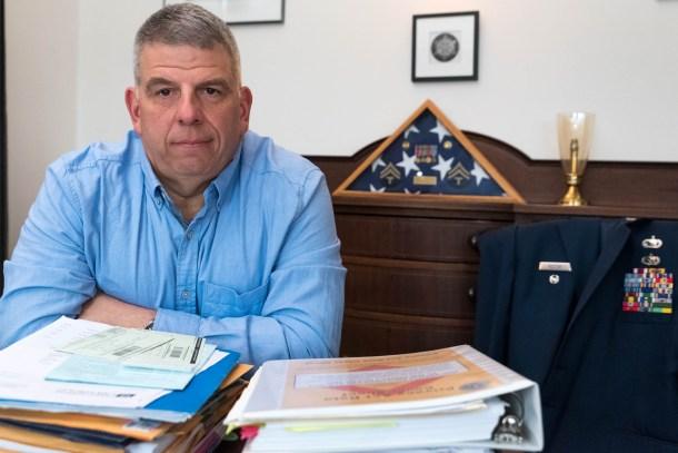 Jeff Rector sits behind his desk