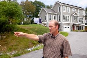 Jim Sullivan pointing at road