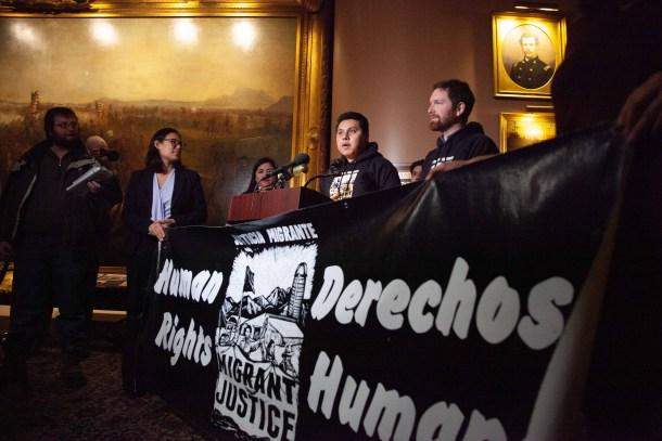 Enrique Balcazar with Migrant Justice banner