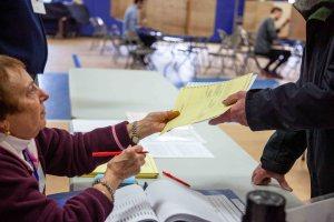 voter picking up ballot