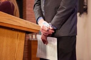 Mark Levine holding face mask