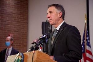 Phil Scott at podium