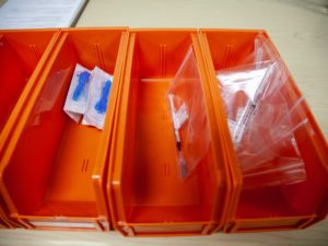 syringes in orange trays