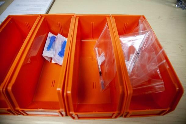 syringes in orange trays