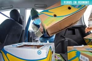 man loading banana boxes into car